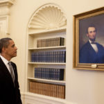 (RNS1-jan16) President Barack Obama looks at the portrait of Abraham Lincoln that hangs in the Oval Office prior to meeting with President Álvaro Uribe of Colombia, June 29, 2009.  RNS photo by Pete Souza/The White House.